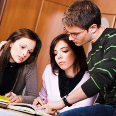 Young students studying together